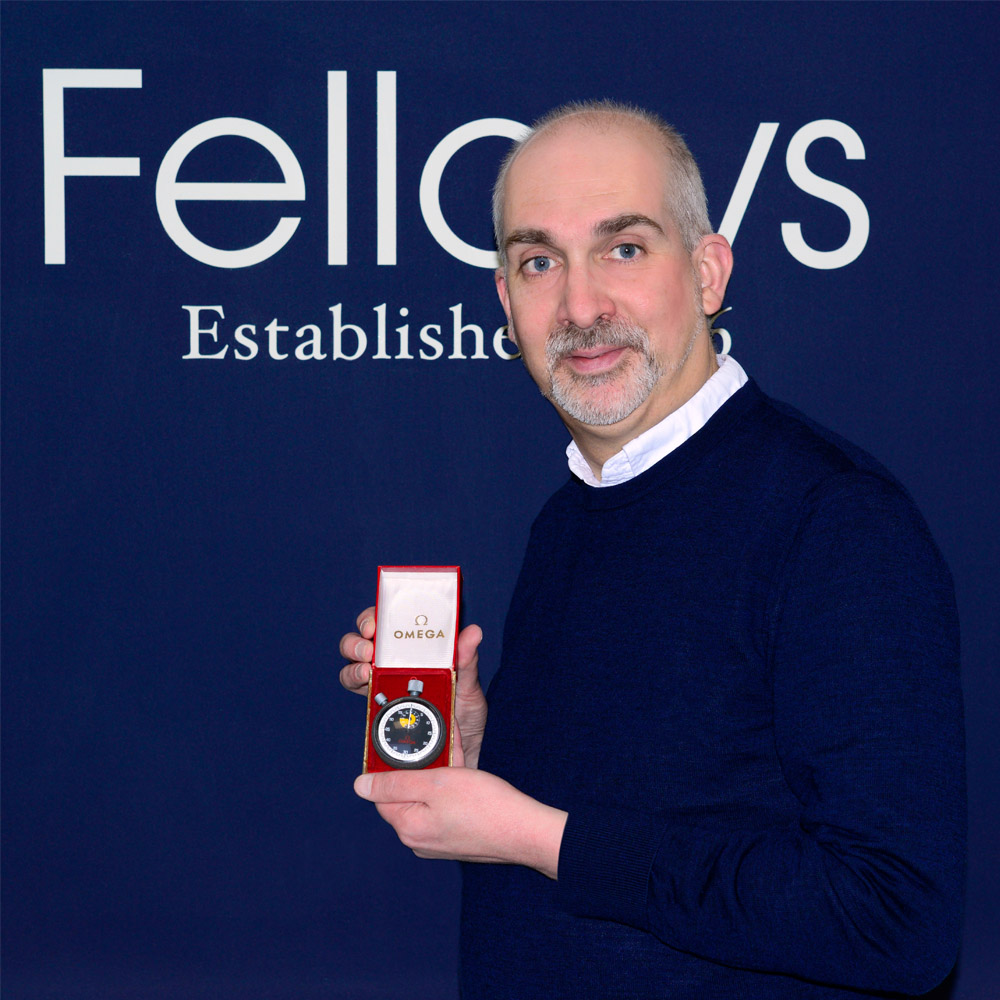 Steven Yambo with Jack Taylor Omega Stopwatch_Property of Fellows Auctioneers